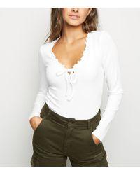 bcf9adea25 New Look - White Long Sleeve Frill Milkmaid Bodysuit - Lyst