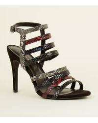 e0642d6ce0e3 New Look Wide Fit Multicoloured Faux Snake Heeled Sandals in Black ...