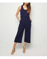 ef066ed6ae92 New Look Petite Navy Ribbed Wrap Front Culotte Jumpsuit in Blue - Lyst