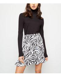 31989fa737 New Look - Black Zebra Print Asymmetric Frill Mini Skirt - Lyst