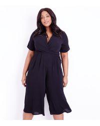 New Look - Curves Black Wrap Front Culotte Jumpsuit - Lyst