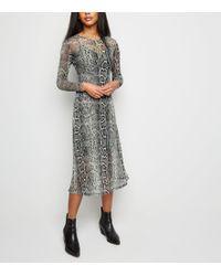 6983d1aad67af Marks   Spencer Floral Print Long Sleeve Tunic Midi Dress in Black ...