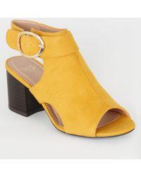 32d027e8358 New Look Wide Fit Mustard Suedette Cross Strap Side Heels in ...