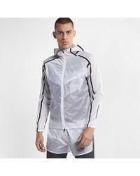 a5a2a4668e5d Nike Rain Runner Hooded Shell Running Jacket in Blue for Men - Lyst