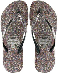 7f9d3b7ee9990 Lyst - Tommy Hilfiger Women s Carma Glitter Flip Flops in Black
