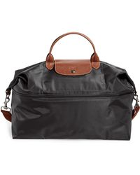 c900f7747 Longchamp Le Pliage Monogrammed Expandable Travel Bag in Blue - Lyst