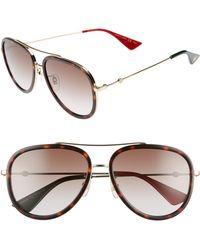 5802cf8e412 Lyst - Gucci 57mm Aviator Sunglasses in Metallic