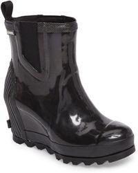 e11b231f7d9 Lyst - Sorel Joan Rain Wedge Tall Boot in Black - Save ...