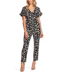 87a73f7a298 Cece - Duchess Floral Print Faux Wrap Jumpsuit - Lyst
