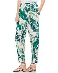 Vince Camuto - Jungle Palm Print Slim Leg Pants - Lyst