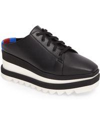 2c5f7a5360d Lyst - Stella McCartney Elyse Faux-leather Flatform Brogues in Black