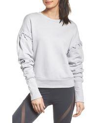 Alo Yoga | Lattice Long Sleeve Pullover | Lyst
