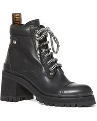 af6268f605f9 Prada Black Lug Sole Boots in Black - Lyst