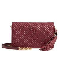 7c458e52598 Lyst - Tory Burch  robinson  Pebbled Leather Crossbody Wallet in Brown