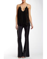 ABS By Allen Schwartz - Metallic Piped Skinny Flared Pant - Lyst