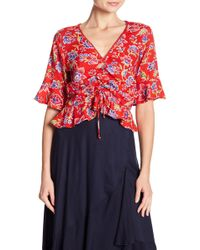 Angie - 3/4 Sleeve Front Tie Floral Print Blouse - Lyst