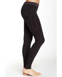 Nikibiki - Vivid Leopard Print Legging - Lyst