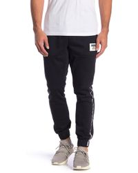 PUMA - Elastic Waist Banded Pants - Lyst