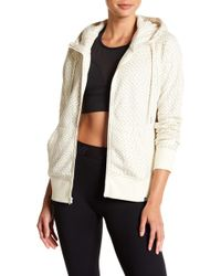 New Balance - Printed Funnel Neck Jacket - Lyst