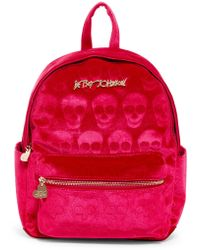 Betsey Johnson - Head Of The Class Skull Embossed Velvet Backpack - Lyst