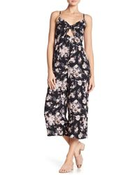 4218a477c6a2 Angie - Spaghetti Strap Floral Print Jumpsuit - Lyst
