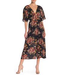June & Hudson - Floral Flutter Sleeve Jumpsuit - Lyst