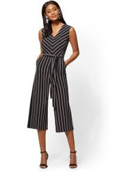 Lyst New York Company Mock Neck Jumpsuit In Blue