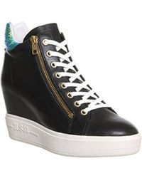 78570caee30d Lyst - Ash Genialbis Buckled Wedge Sneaker in Black