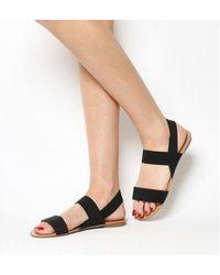 54b4601ba82 Puma Select Elastic Slingback Platform Sandals in Black - Lyst