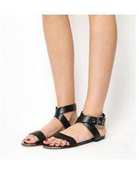 9c5a57af97e Lyst - Ted Baker Flat Leather Strap Sandals in Black