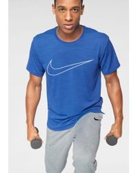 Nike - Trainingsshirt »MEN SUPERSET TOP SHORTSLEEVE GFX« - Lyst