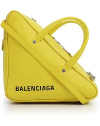 Balenciaga - Triangle Small Duffle Bag Yellow - Lyst