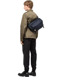b09719e8ed Lyst - Prada Messenger Bag in Blue for Men
