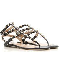 0751c696464121 Lyst - Valentino  rockstud  Bow Flat Jelly Sandals in Black