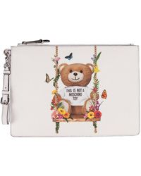 Moschino   White Teddy Clutch In Polyurethane With Iconic Print On The Front And Detachable Wrist Strap   Lyst