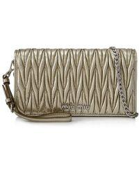 3081ba6cb06 Lyst - Miu Miu Pre-owned Matelasse Shoulder Bag in Natural