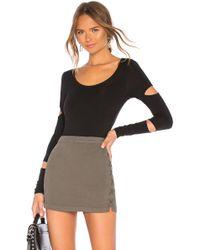 Chaser - Long Sleeve Slit Bodysuit In Black - Lyst