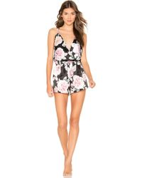 37ee95c75e6 Tropical Tie Front Flare Sleeve Playsuit.  40. Boohoo · Flora Nikrooz -  Lilith Crossover Romper - Lyst