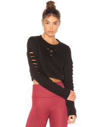Alo Yoga - Ripped Warrior Long Sleeve Top - Lyst