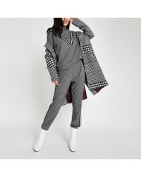 River Island - Black Check Tape Side joggers - Lyst
