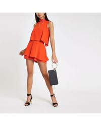 River Island - Bright High Neck Tie Frill Playsuit - Lyst