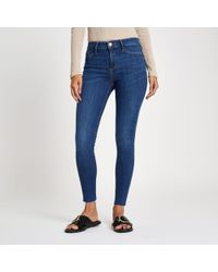 River Island - Mid Blue Molly Mid Rise Jeggings - Lyst