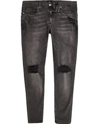 River Island - Black Ollie Ripped Knee Spray On Jeans - Lyst