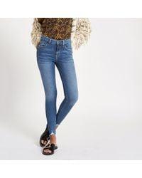 River Island - Mid Blue Denim Amelie Super Skinny Jeans - Lyst