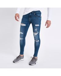 River Island - Mid Blue Ripped Super Skinny Spray On Jeans - Lyst