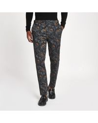 River Island - Blue Crane Print Skinny Smart Trousers - Lyst