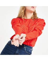 fe111bbd989af Lyst - River Island Red Textured Puff Sleeve Bardot Crop Top in Red