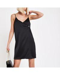f1544866d64fd River Island Petite Polka Dot Wrap Frill Mini Dress in Black - Lyst