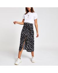 bc0c06a64 River Island Black Zebra Print Asymmetric Midi Skirt in Black - Lyst