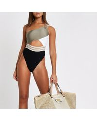 River Island - Khaki Ribbed One Shoulder High Leg Swimsuit - Lyst